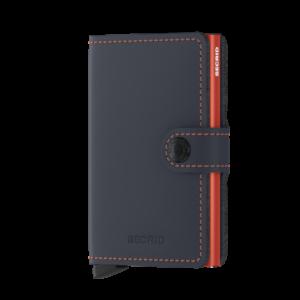 Secrid Miniwallet sötétkék-narancssárga színben, lágy tapintású, sima felületű marhabőrből.